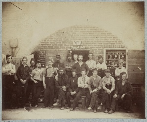 Title: Federal prisoners captured at battle of Bull Run, Castle Pinkney [i.e. Pinckney], Charleston, S.C., August 1861 Summary: Photograph shows group from the 69th New York Infantry [sic](Fighting 69th), some seated, others standing in the rear, facing front. A sign above the door, No. 7 Musical Hall, 444th Broadway. http://www.loc.gov/pictures/item/2013651611/